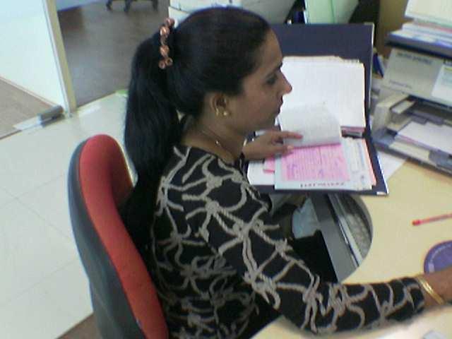 Especiosa, 45 ans, est secrétaire espe